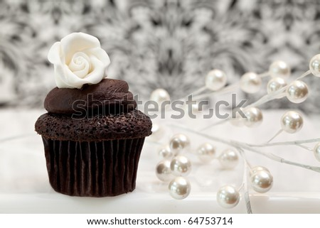 Chocolate Cupcake Against An Elegant Background - stock photo