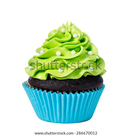 Chocolate cupcake decorated with green icing and sprinkles isolated on white