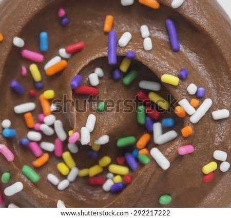 Chocolate cupcake icing with sprinkles - stock photo