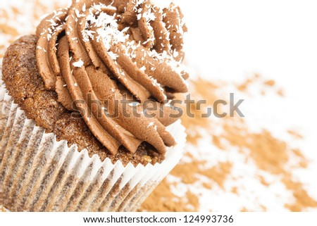 Chocolate cupcake  on cocoa background with space for text - stock photo