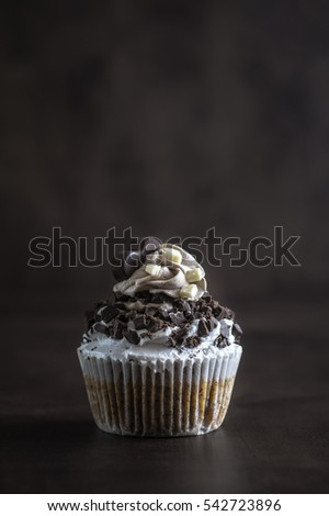 Chocolate cupcake on wooden background