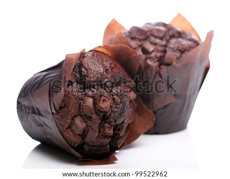 Chocolate cupcake over white background - stock photo