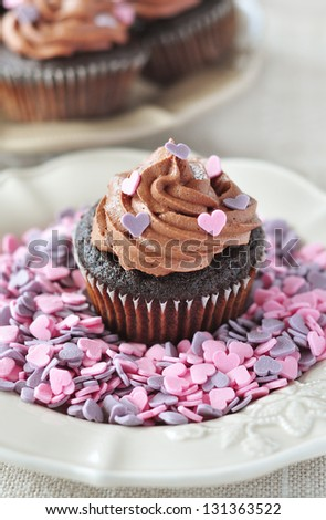 Chocolate cupcake sprinkled with candy hearts