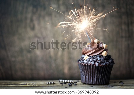 Chocolate cupcake with a sparkler - stock photo