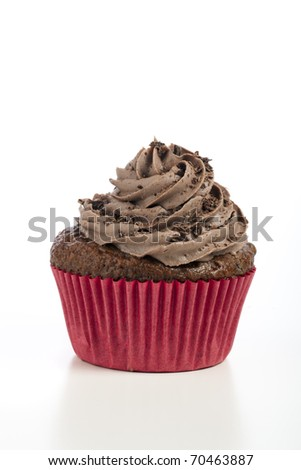 Chocolate cupcake with chocolate icing on white background. - stock photo