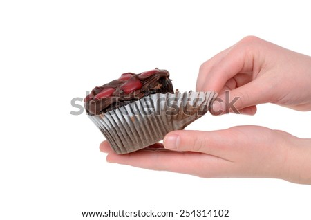 chocolate cupcake with frosting hands holding isolated on white background - stock photo