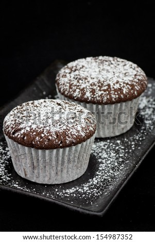 Chocolate cupcake with icing sugar frosting - stock photo