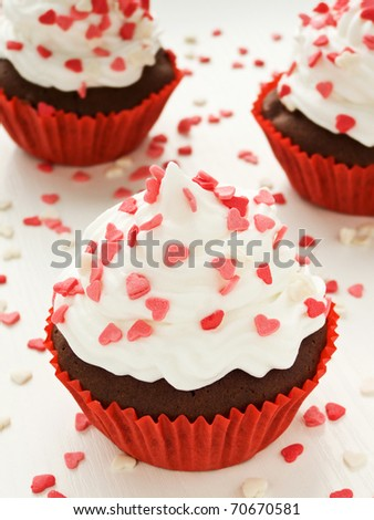 Chocolate cupcakes for Valentine's Day. Shallow dof. - stock photo