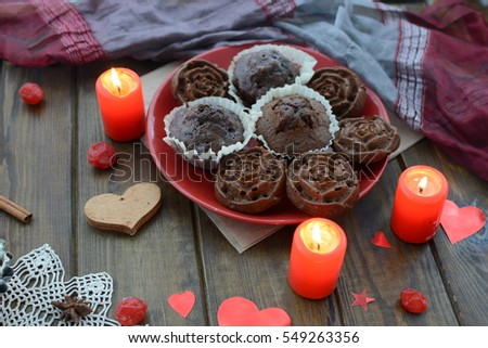 Chocolate cupcakes on the day of lovers and various ornaments in the shape of heart