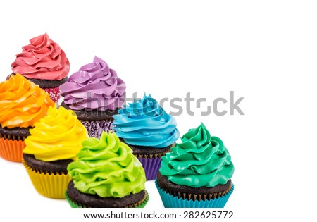 Chocolate cupcakes with colourful icing on a white background.
