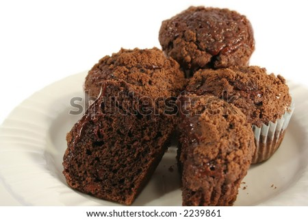 Chocolate cupcakes with crumb topping on a plate and isolated on white ...