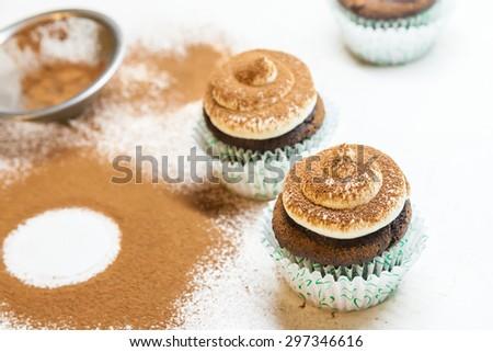 Chocolate cupcakes with mascarpone frosting (Tiramisu cupcakes) - stock photo