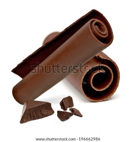 Chocolate curls and parts on white background - stock photo