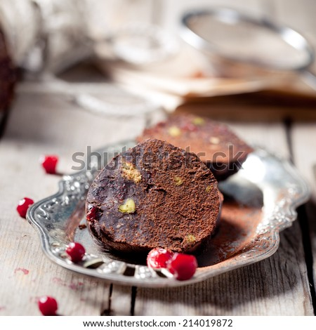 "Chocolate dessert ""salami"" with pistachio nuts, port and cranberry ..."