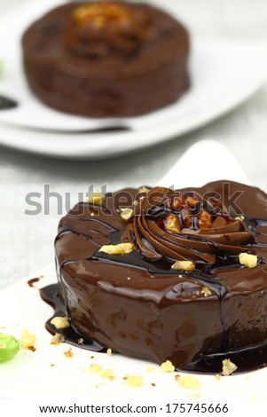 Chocolate dessert with decoration on white plate - stock photo
