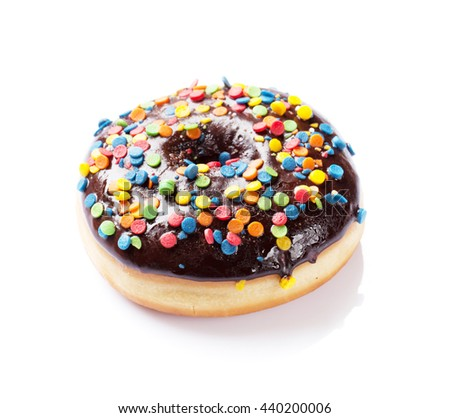 Chocolate donut with colorful decor. Isolated on white background