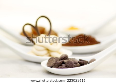 chocolate drop in the foreground with other sweet ingredients in the background - stock photo