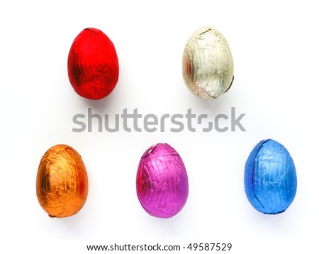 Chocolate Easter Egg treats each wrapped in shiny colorful foil on white
