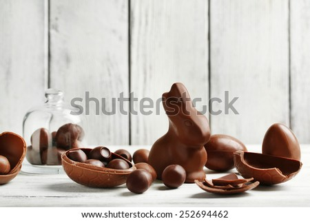 Chocolate Easter Eggs on color wooden background - stock photo