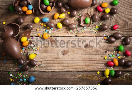 Chocolate Easter Eggs Over Wooden Background - stock photo