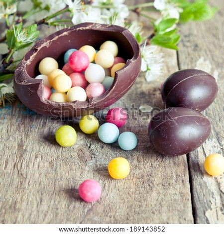 Chocolate Easter Eggs with sweets close up - stock photo