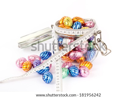 Chocolate easter eggs with tape-measurement - stock photo