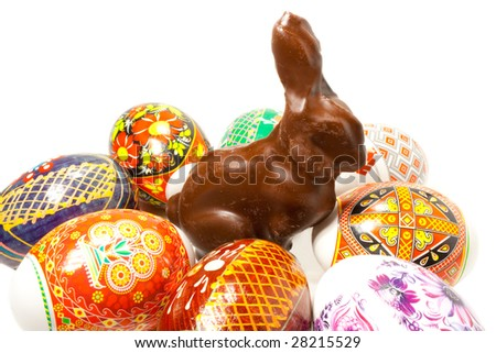 Chocolate easter rabbit in surroundings easter eggs - stock photo