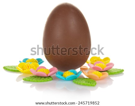 Chocolate egg with marzipan flowers isolated on white background - stock photo