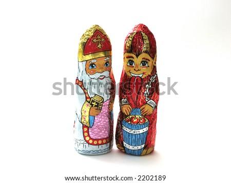 Chocolate figures - Santa Claus and devil - stock photo