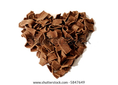 Chocolate flakes in heart shape. Really sweet! Isolated on white background.