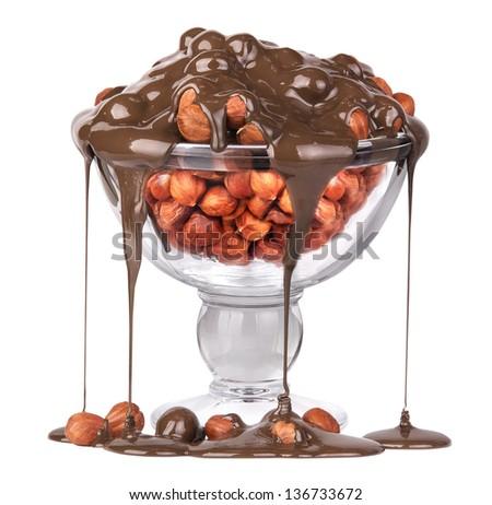 Chocolate Flowing over nuts in a glass  Isolated on White - Tasty look - stock photo