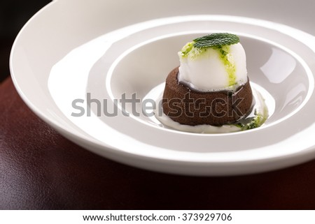 chocolate fondant with ice cream - stock photo