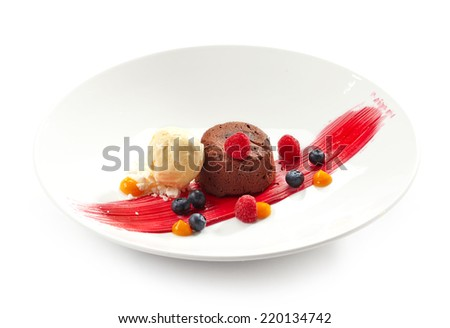 Chocolate fondant with ice cream and fresh berries isolated on white - stock photo