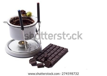 Chocolate fondue on white background - studio shot. - stock photo