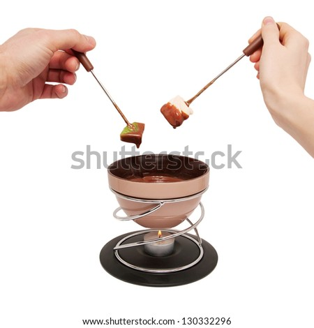Chocolate fondue. Two hands, male and female, with fruit.  Isolated on white background - stock photo