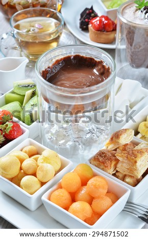 Chocolate fondue with various kind of fruit.   - stock photo