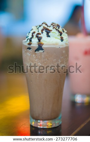 Chocolate frappe on table in cafe - stock photo