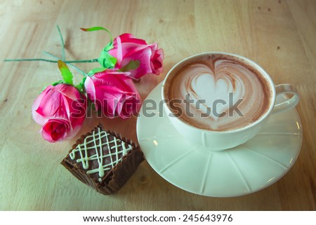 Chocolate heart with roses for sweet time - stock photo