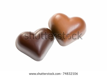 chocolate hearts on white background - stock photo