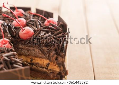 chocolate ice-cream cake on wood background - stock photo