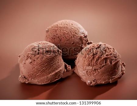 Chocolate Ice cream on brown background - stock photo