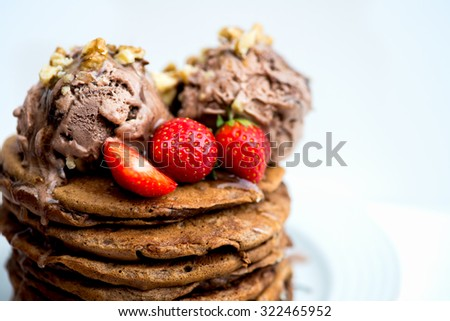 Chocolate Ice Cream Scoops on the Stack of Pancakes with Agave Syrup and Strawberries, selective focus, shallow DOF, macro shot - stock photo