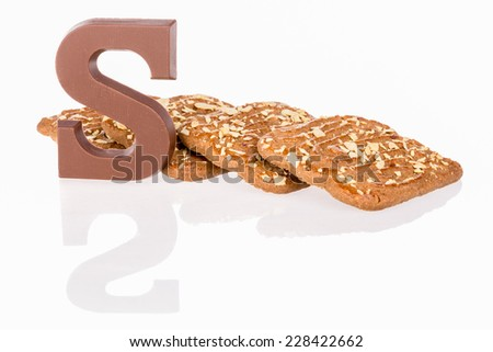 Chocolate letter and biscuits Dutch sweets at 5 december Sinterklaas party - stock photo