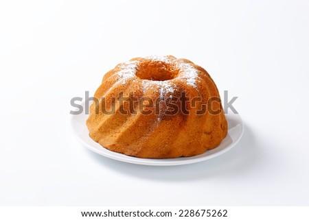Chocolate marble cake on white background - stock photo
