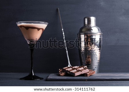 Chocolate martini on the wooden background - stock photo