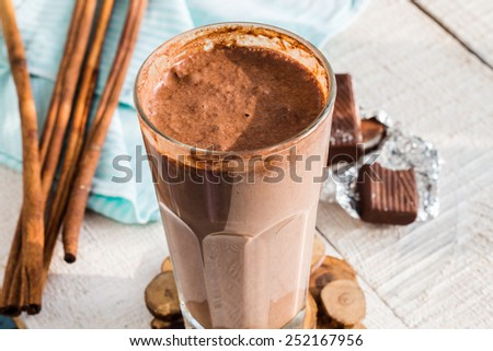 chocolate milk smoothie with banana, peanut butter and cinnamon, breakfast - stock photo