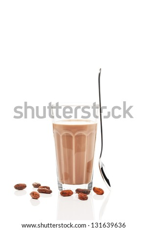 chocolate milk with chocolate beans and a standing spoon on white background - stock photo
