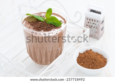chocolate milkshake and ingredients, horizontal, close-up - stock photo