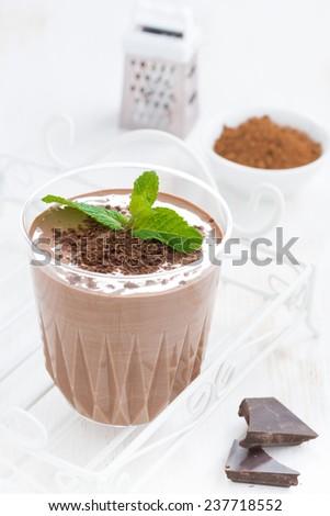 chocolate milkshake and ingredients, vertical, close-up - stock photo