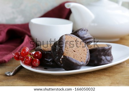 chocolate mini cakes decorated with currants on a white plate